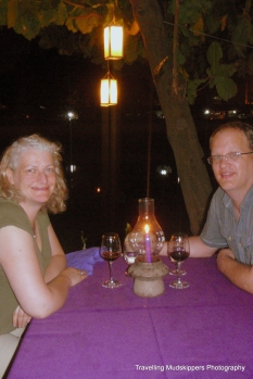 Eating beside the river while listening to live traditional Thai music and sipping wine - a budget-busting must do!
