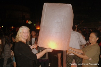 Preparing our New Year's Lantern for flight.  May it bring us Good Luck and Happiness in 2013!
