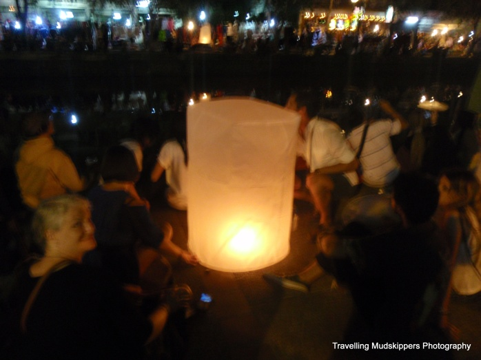 Thousands of burning paper lanterns floated through the night sky above Chiang Mai.  Lighting a lantern is supposed to bring good luck for 2013!